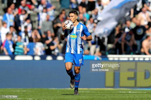Marko Grujic of Hertha Berlin kisses the ball in celebration as he scores his team's first goal during the Bundesliga match between Hertha BSC and...