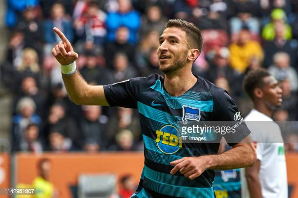 Marko Grujic of Hertha BSC Berlin celebrates after scoring his team's third goal during the Bundesliga match between FC Augsburg and Hertha BSC at...