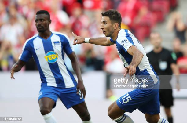 Marko Grujic of Hertha BSC celebrates after scoring his team's first goal with Salomon Kalou during the Bundesliga match between 1 FSV Mainz 05 and...