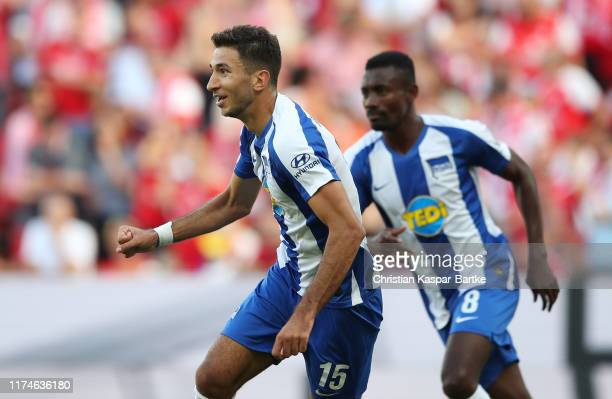 Marko Grujic of Hertha BSC celebrates after scoring his team's first goal with Salomon Kalou during the Bundesliga match between 1. FSV Mainz 05 and...