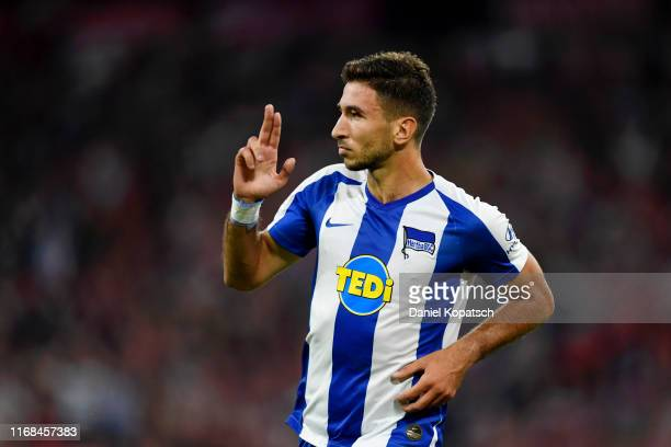 Marko Grujic of Hertha BSC celebrates after scoring his team's second goal during the Bundesliga match between FC Bayern Muenchen and Hertha BSC at...