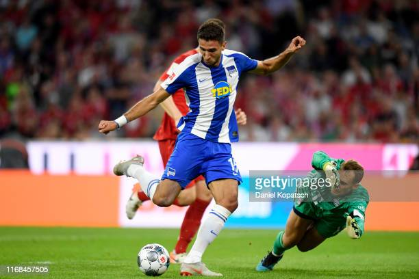 Marko Grujic of Hertha BSC scores his team's second goal past Manuel Neuer of FC Bayern Munich during the Bundesliga match between FC Bayern Muenchen...