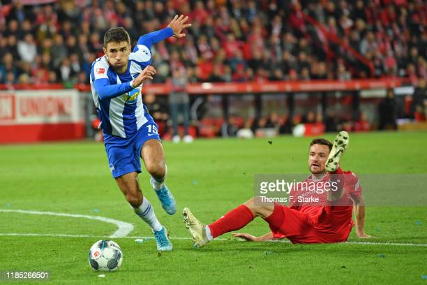 Marko Grujic of Hertha runs past Manuel Schmiedebach of Union during the Bundesliga match between 1. FC Union Berlin and Hertha BSC at Stadion An der...