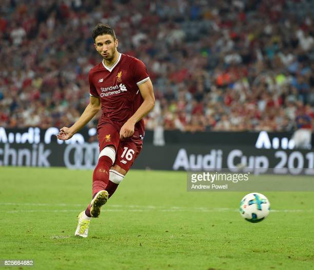 Marko Grujic of Liveprool scores a penalty at the end of the Audi Cup 2017 match between Liverpool FC and Atletico Madrid at Allianz Arena on August...
