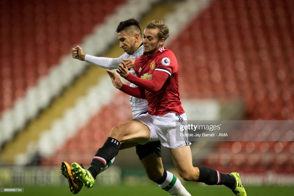 Marko Grujic of Liverpool and James Wilson of Manchester United during the Premier League 2 fixture between Manchester United and Liverpool at Leigh Sports Village on October 23, 2017 in Leigh, Greater Manchester.