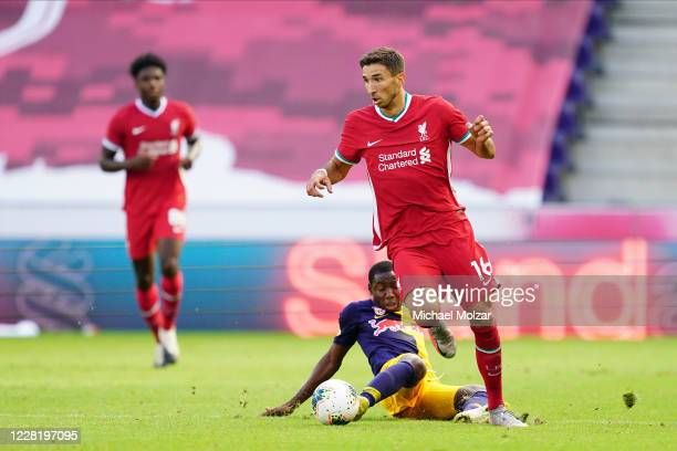 Marko Grujic of Liverpool attacked by Sekou Koita of Salzburg during the friendly match between FC Red Bull Salzburg and FC Liverpool at Red Bull...