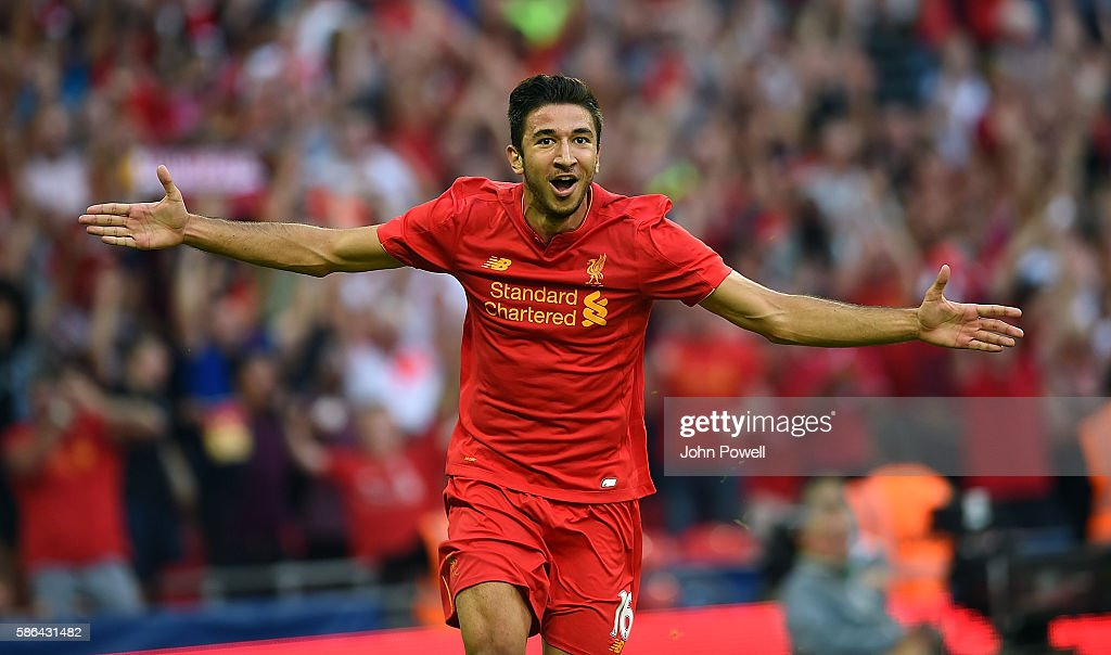 Marko Grujic of Liverpool celebrates after scoring the fourth goal during the International Champions Cup match between Liverpool and Barcelona at Wembley Stadium on August 6, 2016 in London, England.
