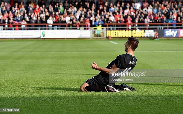 Marko Grujic of Liverpool celebrates after scoring the opening goal during the PreSeason Friendly match bewteen Fleetwood Town and Liverpool at...