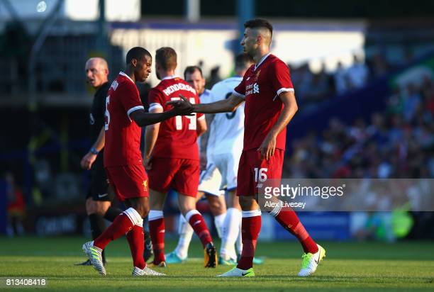 Marko Grujic of Liverpool celebrates with Georginio Wijnaldum after scoring the second goal during a preseason friendly match between Tranmere Rovers...
