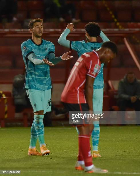 Marko Grujic of Liverpool celebrates with teammate Curtis Jones after scoring his team's sixth goal during the Carabao Cup third round match between...