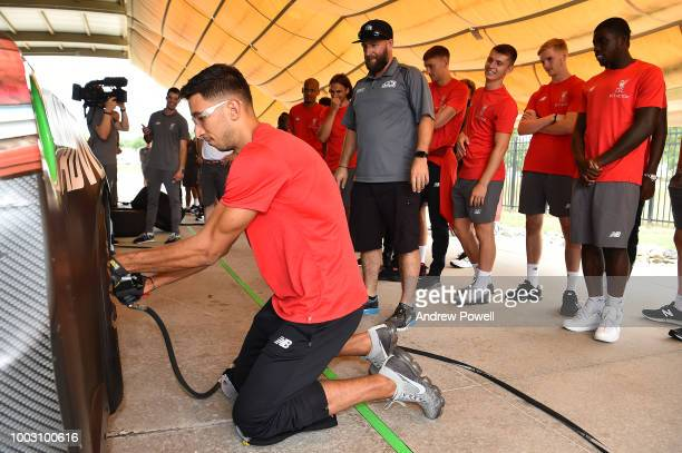 Marko Grujic of Liverpool changing tyres during a tour of Roush Fenway Racing on July 21 2018 in Charlotte North Carolina