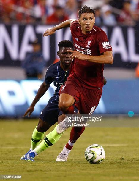 Marko Grujic of Liverpool fights for the ball with Tomiwa DeleBashiru of Manchester City during their match at MetLife Stadium on July 25 2018 in...
