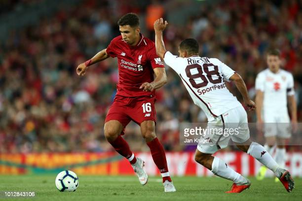 Marko Grujic of Liverpool holds off Tomas Rincon of Torino during the pre-season friendly match between Liverpool and Torino at Anfield on August 7,...