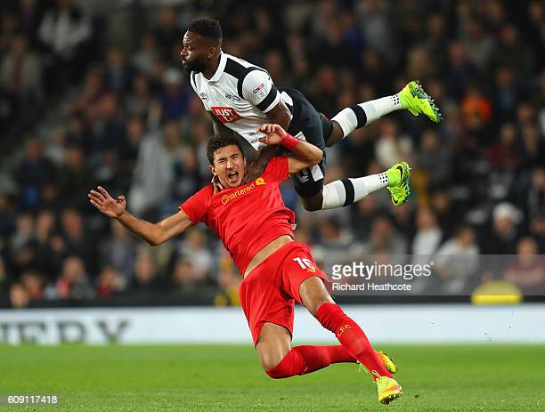 Marko Grujic of Liverpool is challenged by Darren Bent of Derby County during the EFL Cup Third Round match between Derby County and Liverpool at...