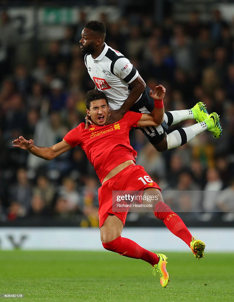 Marko Grujic of Liverpool is challenged by Darren Bent of Derby County during the EFL Cup Third Round match between Derby County and Liverpool at iPro Stadium on September 20, 2016 in Derby, England.