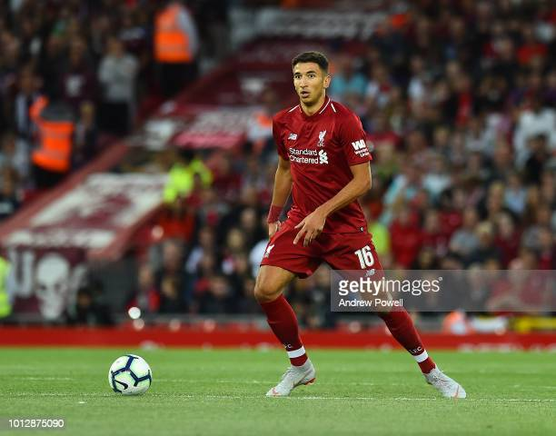 Marko Grujic of Liverpool powers through during the Pre-Season friendly match between Liverpool and Torino at Anfield on August 7, 2018 in Liverpool,...