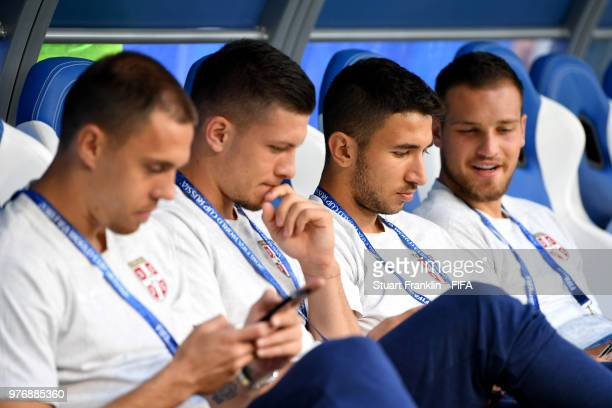 Marko Grujic of Serbia and teammates sit on the bench during a pitch inspection prior to the 2018 FIFA World Cup Russia group E match between Costa...