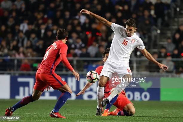 Marko Grujic of Serbia competes for the ball with Jung WooYoung of South Korea during the international friendly match between South Korea and Serbia...