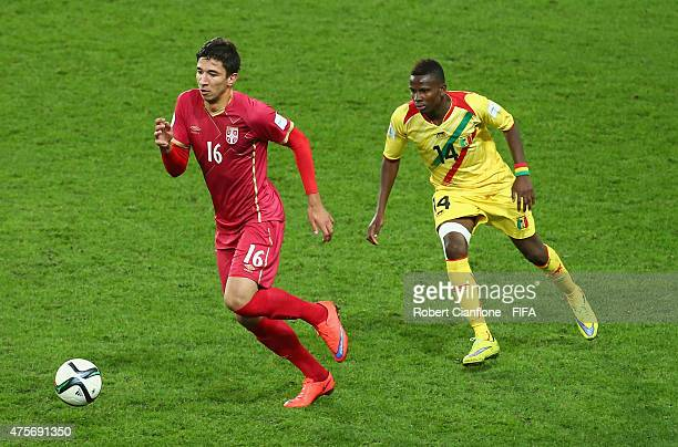Marko Grujic of Serbia is chased by Alassane Diallo of Mali during the FIFA U20 World Cup New Zealand 2015 Group D match between Serbia and Mali at...
