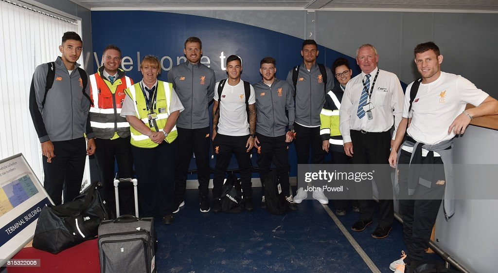 Marko Grujic, Simon Mignolet, Philippe Coutinho, Alberto Moreno and Dejan Lovren of Liverpool pose for a photo at Manchester Airport on July 16, 2017 in Liverpool, England.