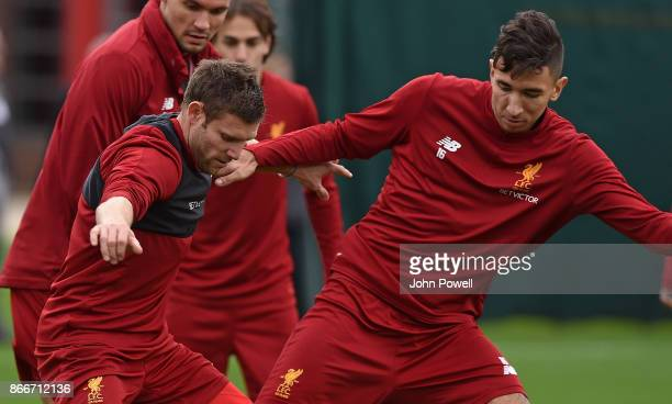 Marko Grujic with James Milner of Liverpool during a training session at Melwood Training Ground on October 26 2017 in Liverpool England