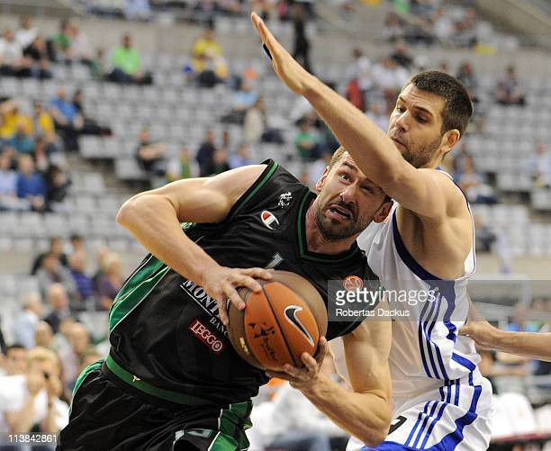 Marko Jaric #19 of Montepaschi Siena competes with Felipe Reyes #9 of Real Madrid in action during the 3rd Place Playoff Turkish Airlines Final Four...