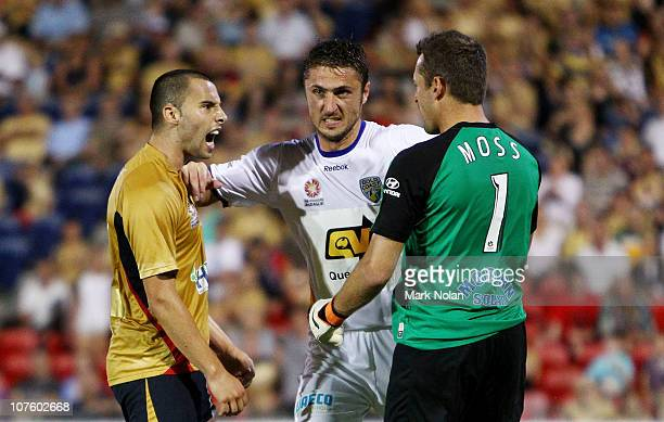 Marko Jesic of the Jets and Glen Moss of the Gold Coast are separated by Dino Djulbic of the Gold Coast after clashing during the round 18 ALeague...
