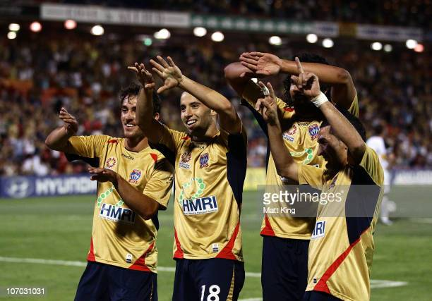 Marko Jesic of the Jets celebrates with team mates after scoring the only goal during the round 15 A-League match between the Newcastle Jets and the...