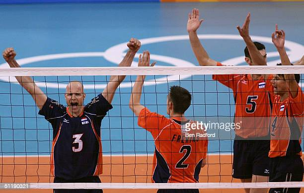 Marko Klok of the Netherlands leads his team in celebration after scoring a point against Brazil in a men's indoor Volleyball preliminary match on...