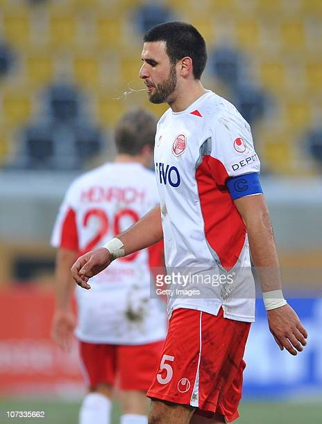 Marko Kopilas of Offenbach walks off the pitch after he's been shown the second yellow card during the Third League match between Dynamo Dresden and...