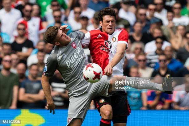 Marko Kvasina of FC Twente Eric Botteghin of Feyenoord during the Dutch Eredivisie match between Feyenoord Rotterdam and FC Twente at the Kuip on...