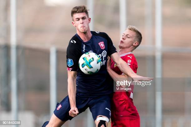 Marko Kvasina of FC Twente Timo Baumgartl of VFB Stuttgart during the friendly match between FC Twente and VFB Stuttgart at the La Manga Club Resort...