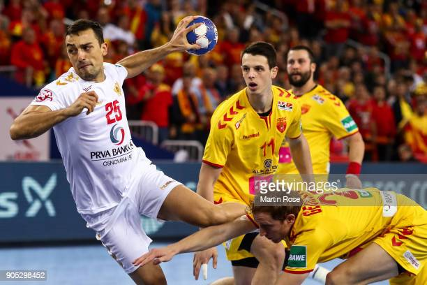 Marko Lasica of Montenegro is challenged by Goce Georgievski of Macedonia during the Men's Handball European Championship Group C match between...