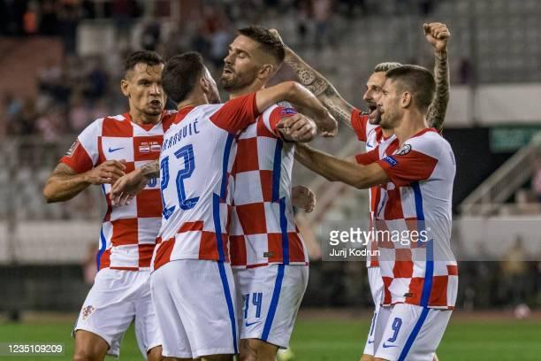 Marko Livaja of Croatia and teammates celebrate Croatia's opening goal during the 2022 FIFA World Cup Qualifier match between Croatia and Slovenia at...