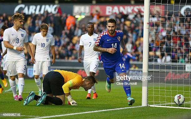 Marko Livaja of Croatia runs away to celebrate after scoring the first goal past England keeper Jack Butland during the UEFA U21 Championship Playoff...