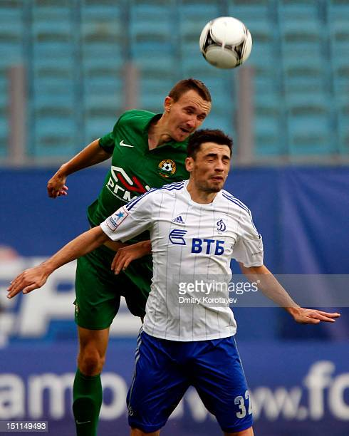 Marko Lomic of FC Dynamo Moscow battles for the ball with Aleksei Kozlov of FC Kuban Krasnodar during the Russian Premier League match between FC...
