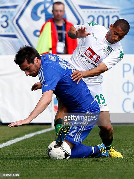 Marko Lomic of FC Dynamo Moscow is challenged by Isael of FC Krasnodar during the Russian Premier League match between FC Dynamo Moscow and FC...
