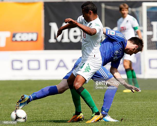 Marko Lomic of FC Dynamo Moscow is challenged by Wanderson of FC Krasnodar during the Russian Premier League match between FC Dynamo Moscow and FC...