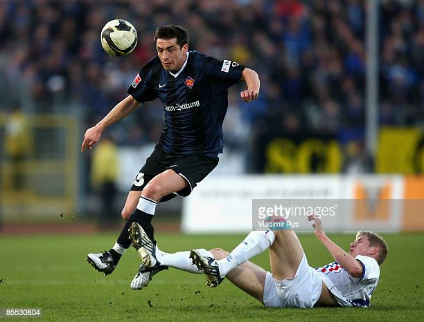 Marko Lomic of Koblenz is tackled by Kevin Schindler of Rostock during the second Bundesliga match at the Oberwerth stadium on March 20 2009 in...