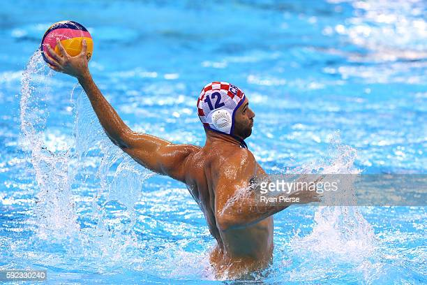 Marko Macan of Croatia throws the ball during the Men's Water Polo Gold Medal match between Croatia and Serbia on Day 15 of the Rio 2016 Olympic...