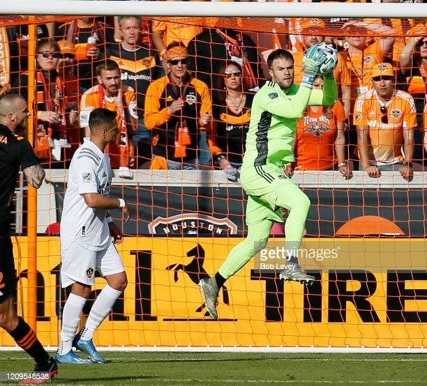 Marko Maric of Houston Dynamo makes a save as Javier Hernandez of Los Angeles Galaxy looks on at BBVA Stadium on February 29 2020 in Houston Texas