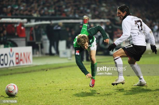 Marko Marin of Bremen and Alexander Bugera of Kaiserslautern battle for the ball during the Bundesliga match between SV Werder Bremen and 1 FC...
