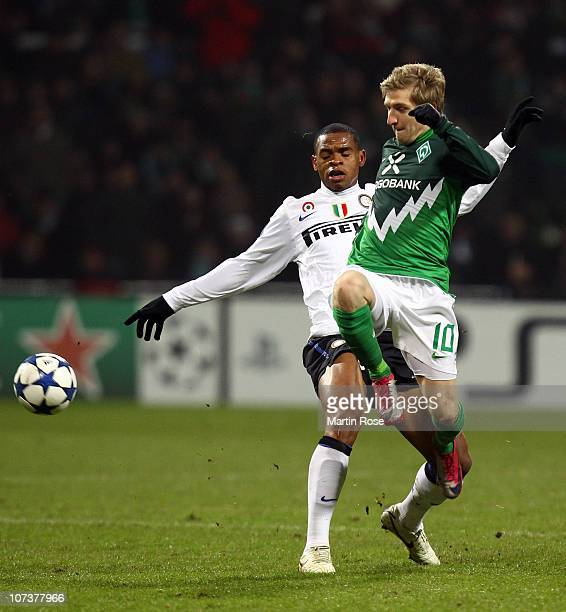 Marko Marin of Bremen and Obiora Nwankwo of Milano compete for the ball during the UEFA Champions League group A match between SV Werder Bremen and...