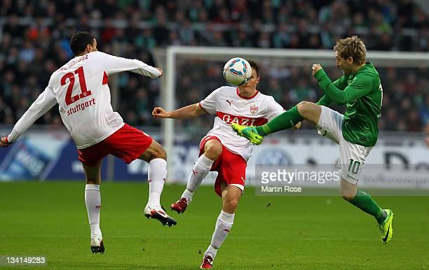 Marko Marin of Bremen and William Kvist of Stuttgart battle for the ball during the Bundesliga match between Werder Bremen and VfB Stuttgart at Weser...