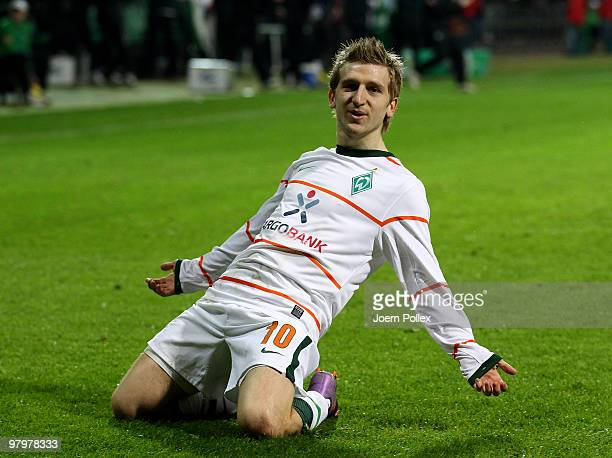Marko Marin of Bremen celebrates after scoring his team's first goal during the DFB Cup Semi Final match between SV Werder Bremen and FC Augsburg at...