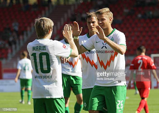 Marko Marin of Bremen celebrates his first goal with his team mate Florian Hartherz during the Season Friendly match between Union Berlin and Werder...