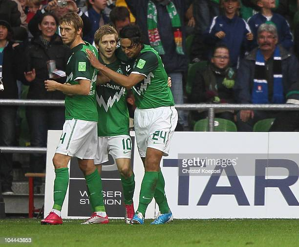 Marko Marin of Bremen celebrates the first goal with Aaron Hunt and Claudio Pizarro of Bremen during the Bundesliga match between Werder Bremen and...