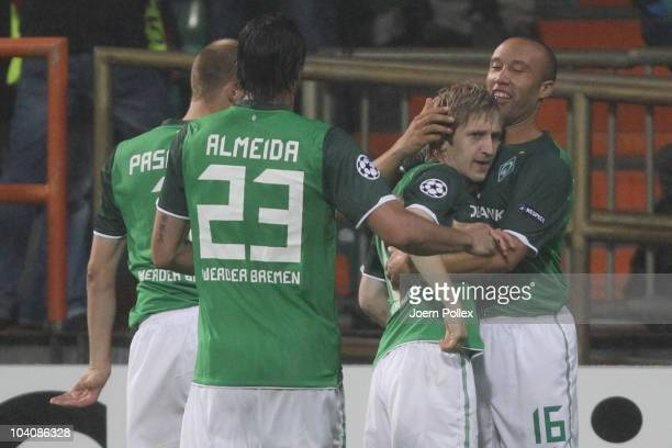 Marko Marin of Bremen celebrates with his team mate Mikael Silvestre after scoring his team's second goal during the UEFA Champions League group A...