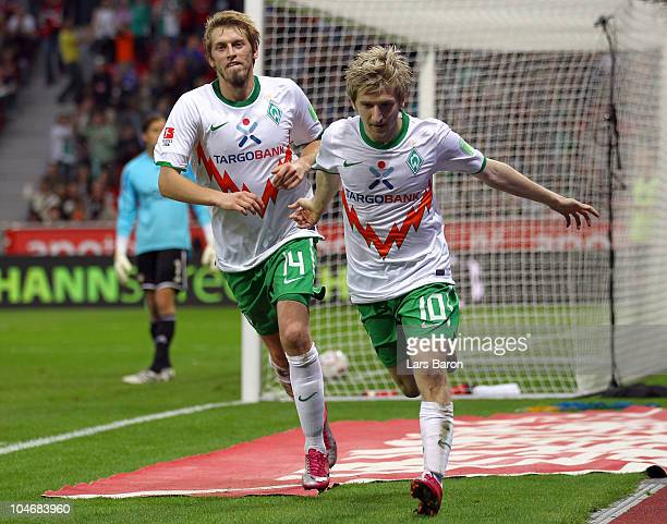 Marko Marin of Bremen celebrates with team mate Aaron Hunt after scoring his teams second goal during the Bundesliga match between Bayer Leverkusen...