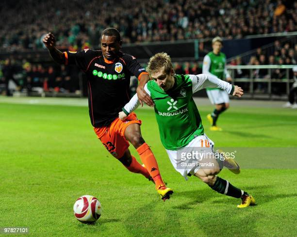 Marko Marin of Bremen is challenged by Miguel of Valencia during the UEFA Europa League round of 16 second leg match between SV Werder Bremen and...